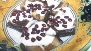 Roasted Eggplant with Tahini Sauce and Pomegranate Seeds Photo by Veronica Hackethal
